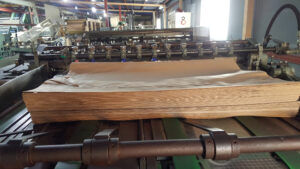 Bottomer for multiwall paper sack production